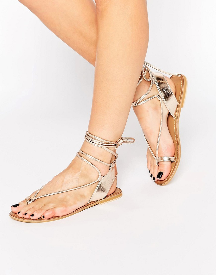 Foxy Leather Tie Leg Sandals Gold - predominant colour: gold; occasions: casual, holiday; material: leather; heel height: flat; ankle detail: ankle tie; heel: standard; toe: toe thongs; style: standard; finish: metallic; pattern: plain; season: s/s 2016; wardrobe: basic