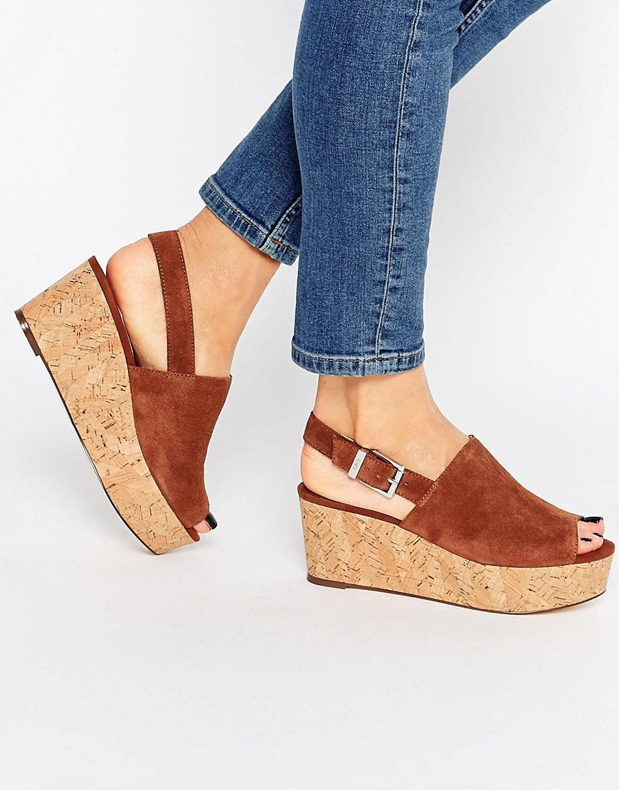 Damage Tan Cork Effect Wedge Sandals Tan - predominant colour: chocolate brown; occasions: casual, holiday; material: suede; heel height: mid; heel: wedge; toe: open toe/peeptoe; style: standard; finish: plain; pattern: plain; shoe detail: platform; season: s/s 2016; wardrobe: investment