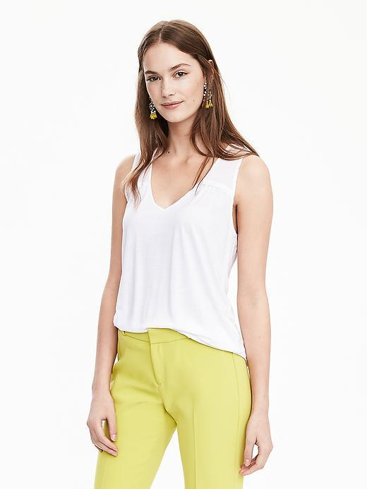 Sleeveless Scoop Top White - neckline: v-neck; pattern: plain; sleeve style: sleeveless; style: vest top; predominant colour: white; occasions: casual; length: standard; fibres: viscose/rayon - 100%; fit: body skimming; sleeve length: sleeveless; pattern type: fabric; texture group: jersey - stretchy/drapey; season: s/s 2016; wardrobe: basic
