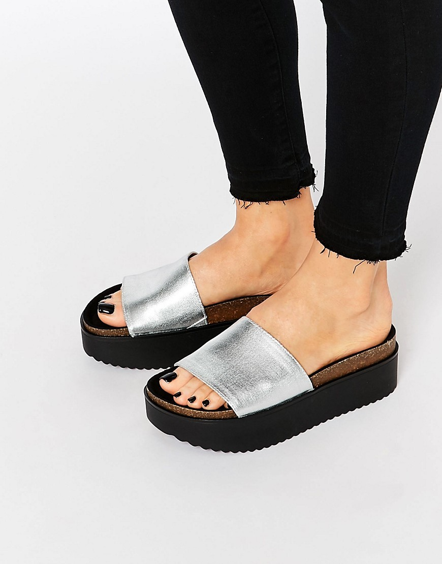 Metallic Platform Sliders Silver - predominant colour: silver; secondary colour: black; occasions: casual; material: leather; heel height: flat; heel: block; toe: open toe/peeptoe; style: slides; finish: metallic; pattern: plain; shoe detail: platform; season: s/s 2016; wardrobe: highlight