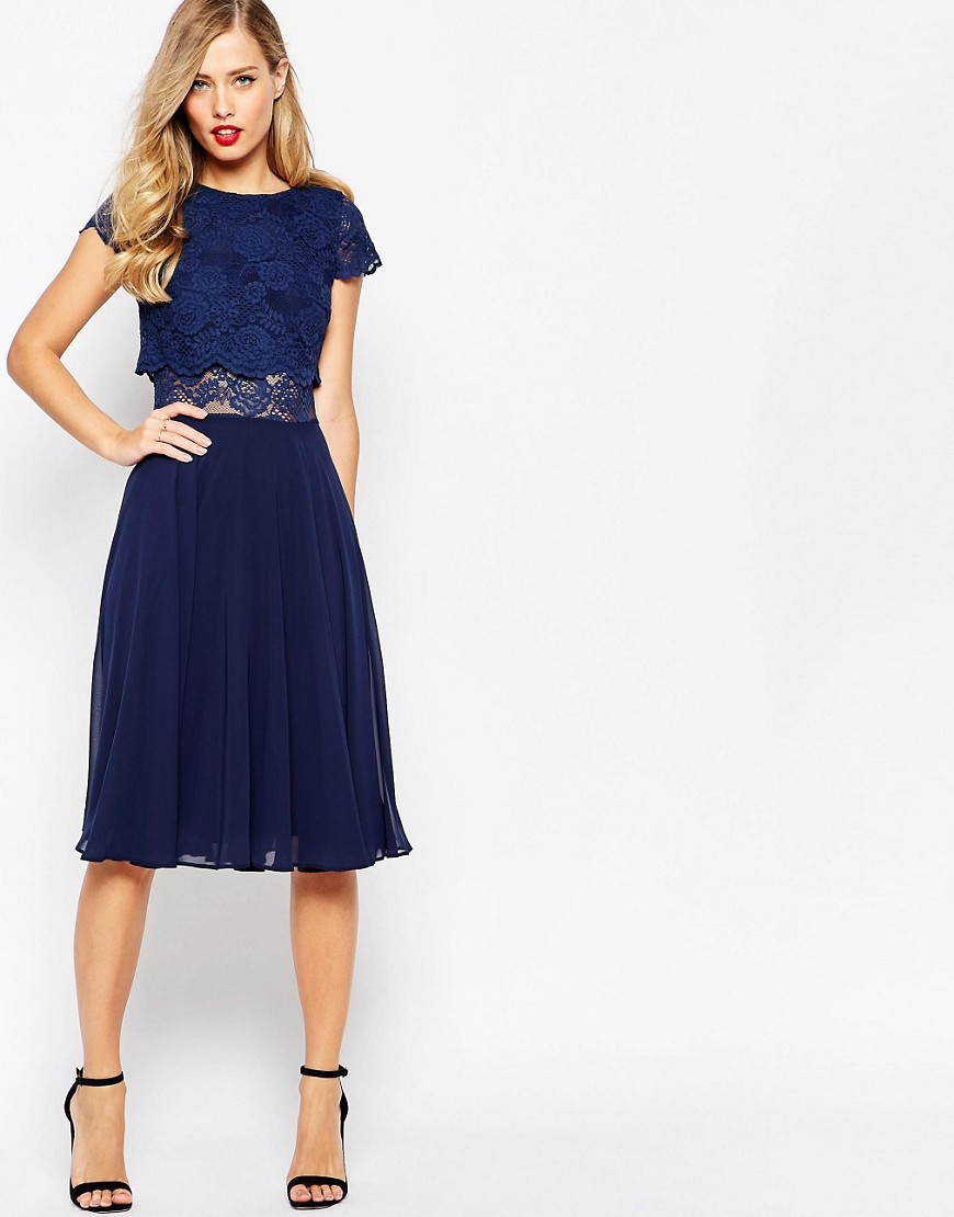 Crop Top Lace Midi Dress Navy - length: below the knee; sleeve style: capped; predominant colour: navy; occasions: evening, occasion; fit: fitted at waist & bust; style: fit & flare; fibres: polyester/polyamide - 100%; neckline: crew; hip detail: subtle/flattering hip detail; waist detail: cut out detail; sleeve length: short sleeve; texture group: sheer fabrics/chiffon/organza etc.; pattern type: fabric; pattern size: light/subtle; pattern: patterned/print; season: s/s 2016; wardrobe: event; embellishment: contrast fabric; embellishment location: bust