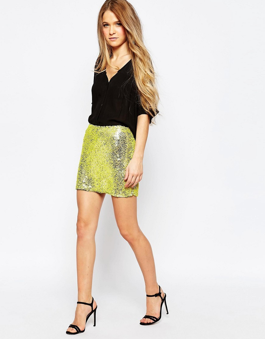 Yellow Sequin Mini Skirt Yellow - length: mini; pattern: plain; fit: tailored/fitted; waist: high rise; predominant colour: lime; secondary colour: gold; occasions: evening; style: mini skirt; fibres: polyester/polyamide - 100%; pattern type: fabric; texture group: other - light to midweight; embellishment: sequins; season: s/s 2016; wardrobe: event; embellishment location: all over