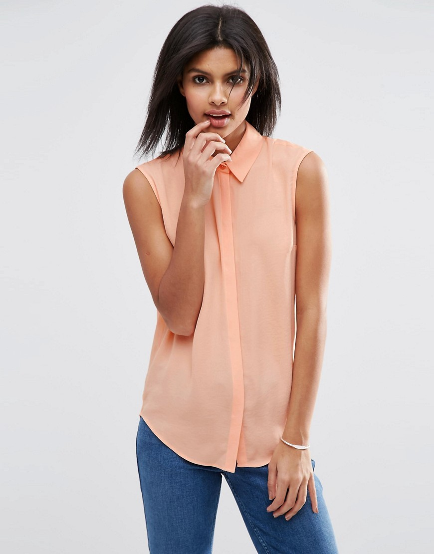 Sleeveless Blouse Coral - neckline: shirt collar/peter pan/zip with opening; pattern: plain; sleeve style: sleeveless; style: blouse; predominant colour: coral; occasions: casual, creative work; length: standard; fibres: polyester/polyamide - 100%; fit: body skimming; sleeve length: sleeveless; texture group: sheer fabrics/chiffon/organza etc.; pattern type: fabric; season: s/s 2016; wardrobe: highlight