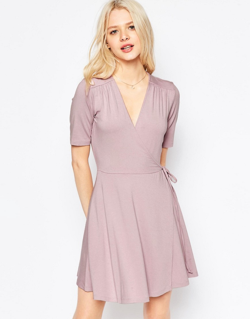 Mini Tea Dress With Wrap Front Dusty Lilac - style: faux wrap/wrap; length: mid thigh; neckline: v-neck; pattern: plain; waist detail: belted waist/tie at waist/drawstring; predominant colour: lilac; occasions: casual; fit: body skimming; fibres: viscose/rayon - stretch; sleeve length: short sleeve; sleeve style: standard; pattern type: fabric; texture group: jersey - stretchy/drapey; season: s/s 2016; wardrobe: highlight
