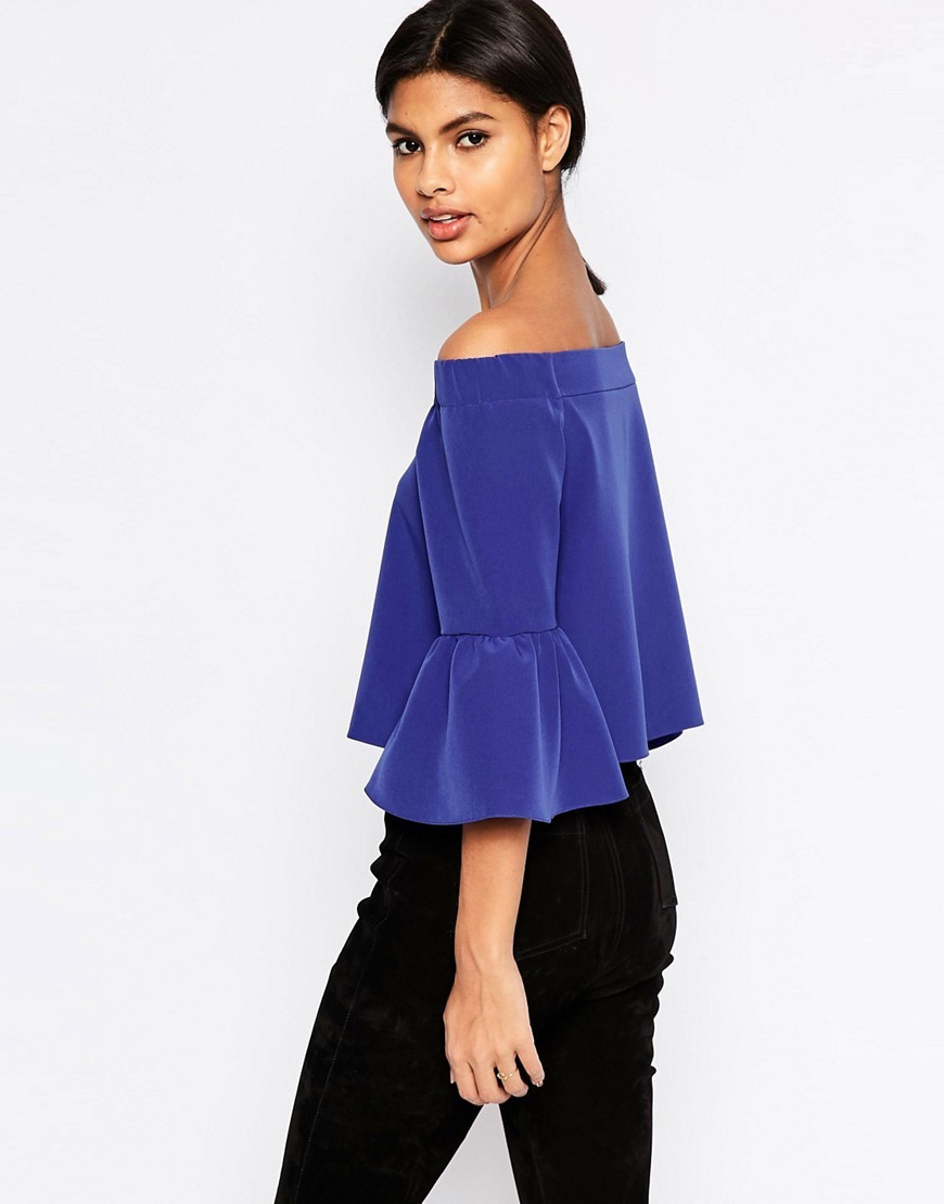 Off The Shoulder Top With Ruffle Sleeve Cobalt - neckline: off the shoulder; sleeve style: bell sleeve; pattern: plain; length: cropped; predominant colour: royal blue; occasions: evening; style: top; fibres: polyester/polyamide - stretch; fit: loose; sleeve length: 3/4 length; pattern type: fabric; texture group: other - light to midweight; season: s/s 2016; wardrobe: event