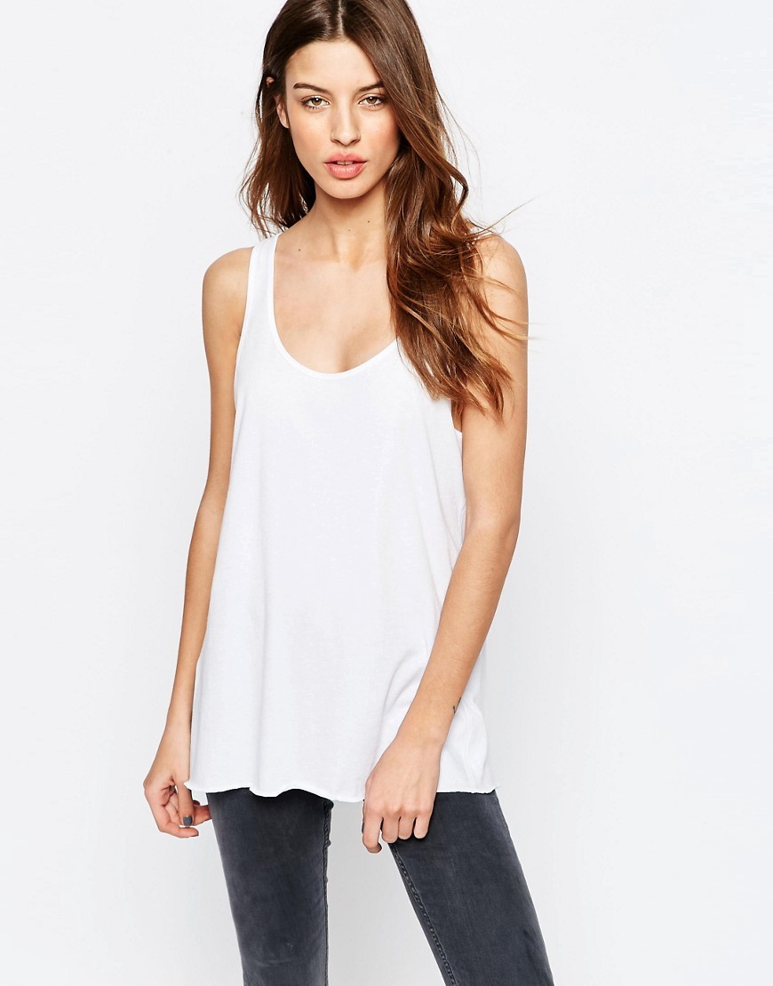Cotton Jersey Vest White - pattern: plain; sleeve style: sleeveless; length: below the bottom; style: vest top; predominant colour: white; occasions: casual; neckline: scoop; fibres: cotton - 100%; fit: body skimming; sleeve length: sleeveless; pattern type: fabric; texture group: jersey - stretchy/drapey; season: s/s 2016; wardrobe: basic