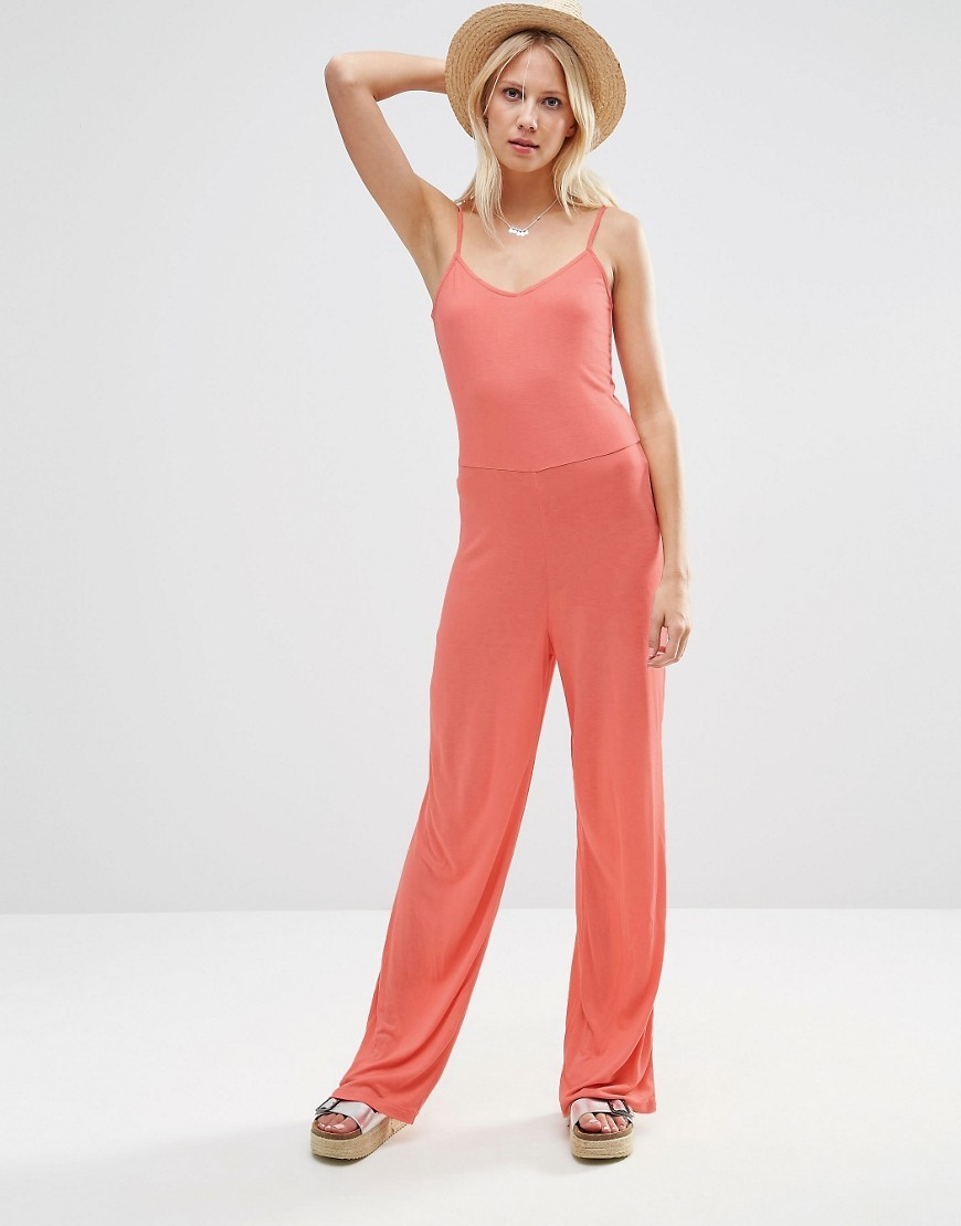 Cami Jumpsuit With Wide Leg Coral - length: standard; neckline: low v-neck; sleeve style: spaghetti straps; pattern: plain; predominant colour: coral; occasions: casual; fit: body skimming; fibres: viscose/rayon - 100%; sleeve length: sleeveless; style: jumpsuit; pattern type: fabric; texture group: jersey - stretchy/drapey; season: s/s 2016; wardrobe: highlight