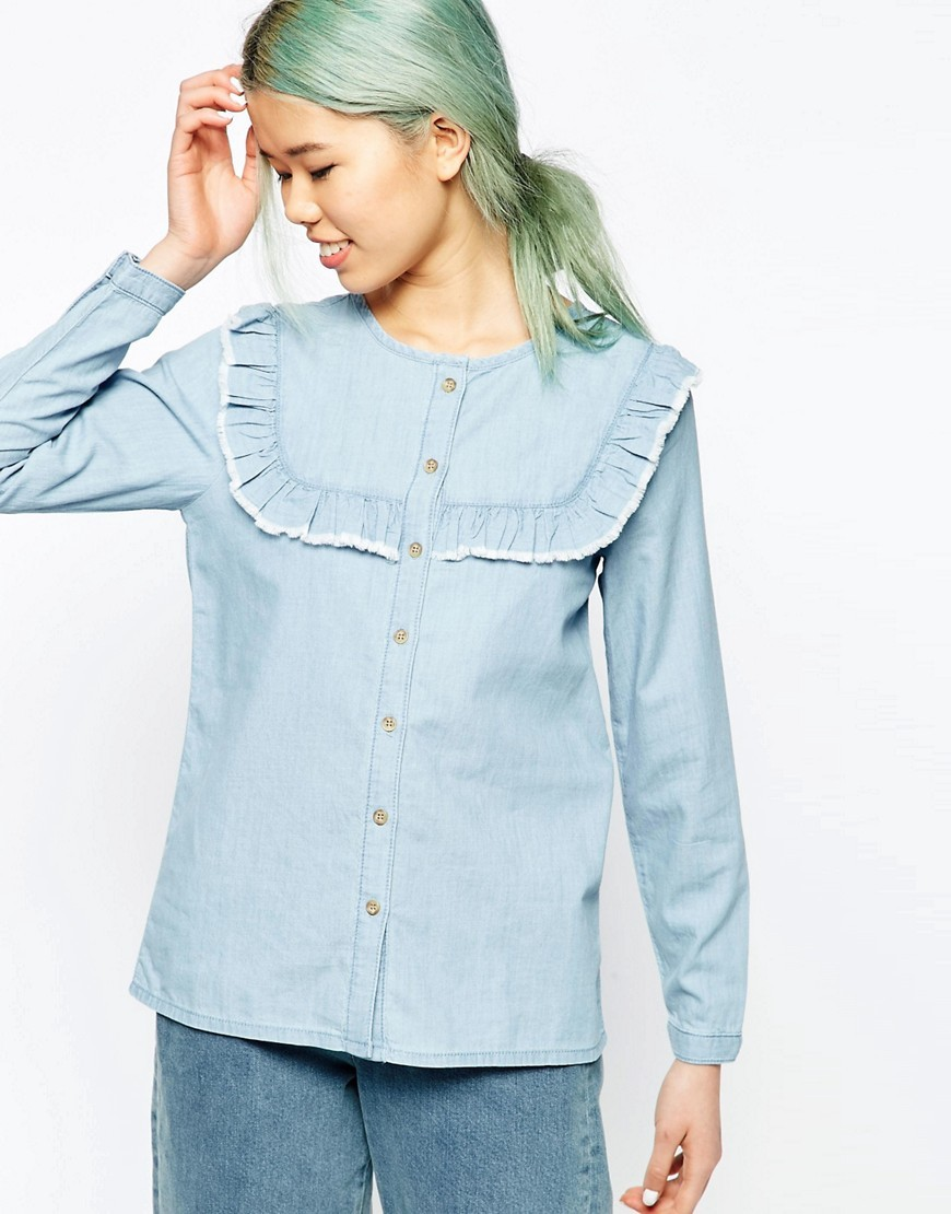 Denim Shirt With Ruffle Bib Detail Lightwash Blue - neckline: round neck; pattern: plain; back detail: racer back/sports back; style: blouse; secondary colour: white; predominant colour: pale blue; occasions: casual; length: standard; fibres: cotton - 100%; fit: straight cut; sleeve length: long sleeve; sleeve style: standard; texture group: denim; bust detail: tiers/frills/bulky drapes/pleats; pattern type: fabric; season: s/s 2016