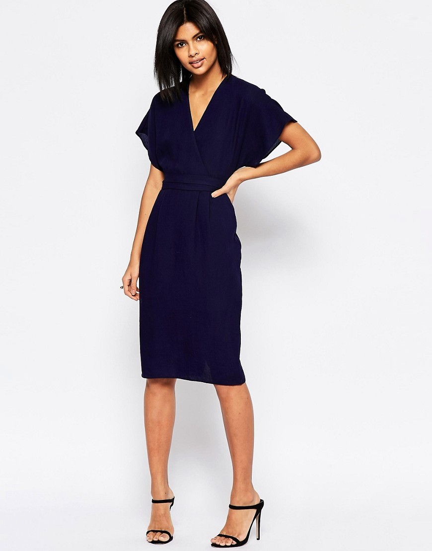 Obi Wrap Dress Navy - style: shift; neckline: v-neck; sleeve style: capped; pattern: plain; predominant colour: navy; occasions: evening, occasion; length: on the knee; fit: body skimming; sleeve length: short sleeve; pattern type: fabric; texture group: woven light midweight; fibres: viscose/rayon - mix; season: s/s 2016; wardrobe: event