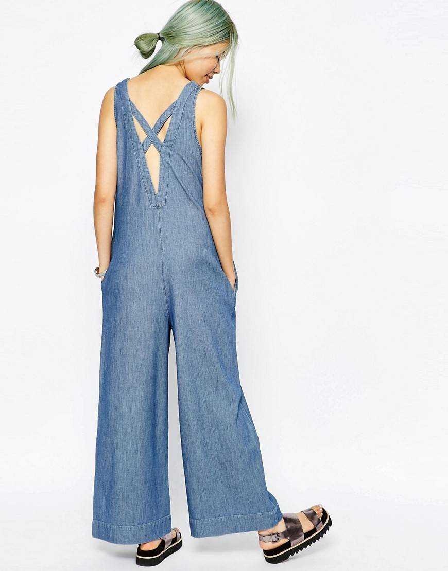 Denim Premium Jumpsuit With Low Back Midwash Blue - length: standard; neckline: low v-neck; fit: loose; pattern: plain; sleeve style: sleeveless; predominant colour: denim; occasions: casual; fibres: cotton - stretch; sleeve length: sleeveless; texture group: denim; style: jumpsuit; pattern type: fabric; season: s/s 2016; wardrobe: highlight