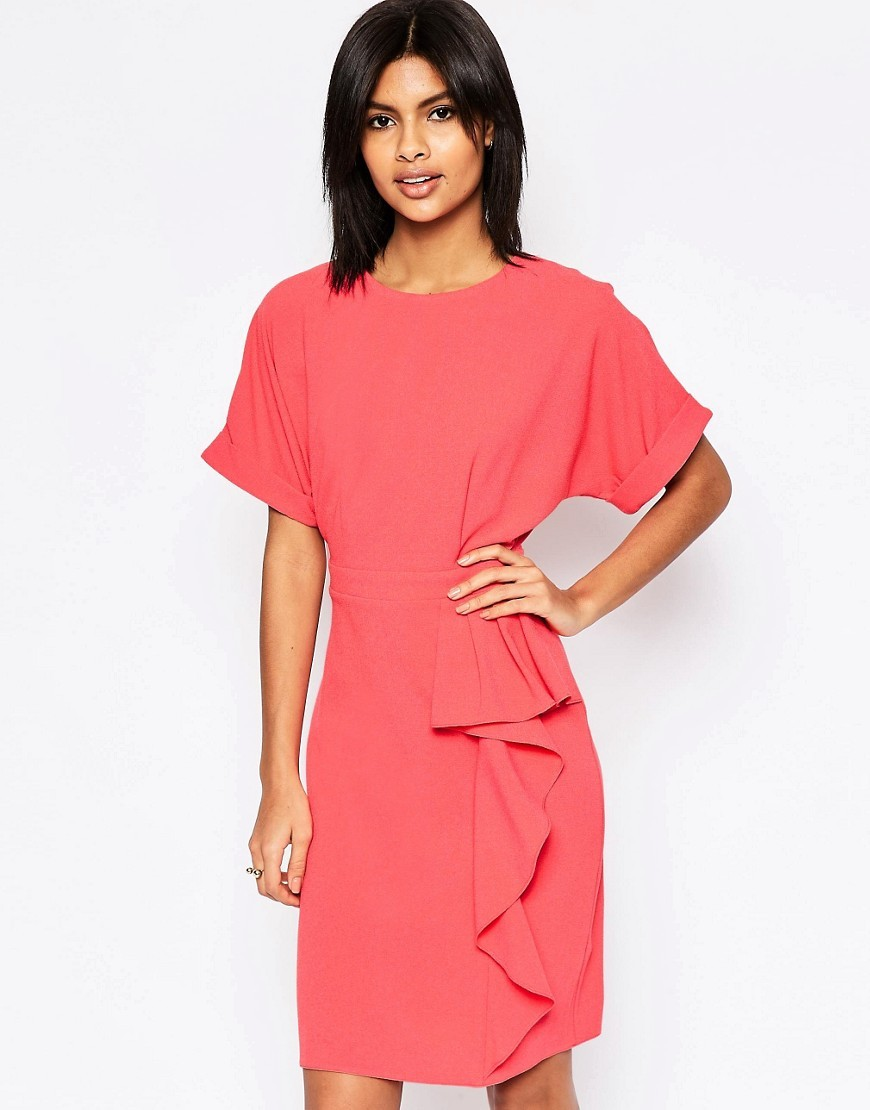 Waterfall Pencil Dress Coral - style: shift; pattern: plain; predominant colour: coral; occasions: evening; length: just above the knee; fit: body skimming; fibres: polyester/polyamide - stretch; neckline: crew; sleeve length: short sleeve; sleeve style: standard; hip detail: ruffles/tiers/tie detail at hip; pattern type: fabric; texture group: jersey - stretchy/drapey; season: s/s 2016