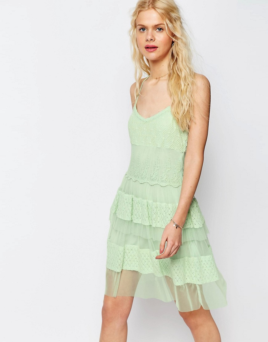 Premium Lace Tiered Mini Dress Soft Green - neckline: low v-neck; sleeve style: spaghetti straps; style: prom dress; predominant colour: pistachio; occasions: evening; length: just above the knee; fit: fitted at waist & bust; fibres: polyester/polyamide - mix; sleeve length: sleeveless; texture group: lace; pattern type: fabric; pattern size: standard; pattern: patterned/print; embellishment: lace; season: s/s 2016; wardrobe: event; embellishment location: skirt, top