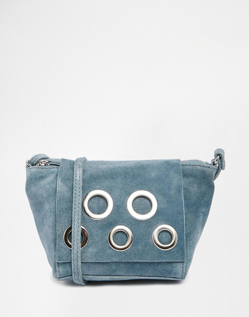 Festival Suede Eyelet Cross Body Bag Duck Egg Blue - predominant colour: pale blue; occasions: casual, creative work; type of pattern: light; style: saddle; length: across body/long; size: small; material: suede; pattern: plain; finish: plain; embellishment: chain/metal; season: s/s 2016; wardrobe: highlight