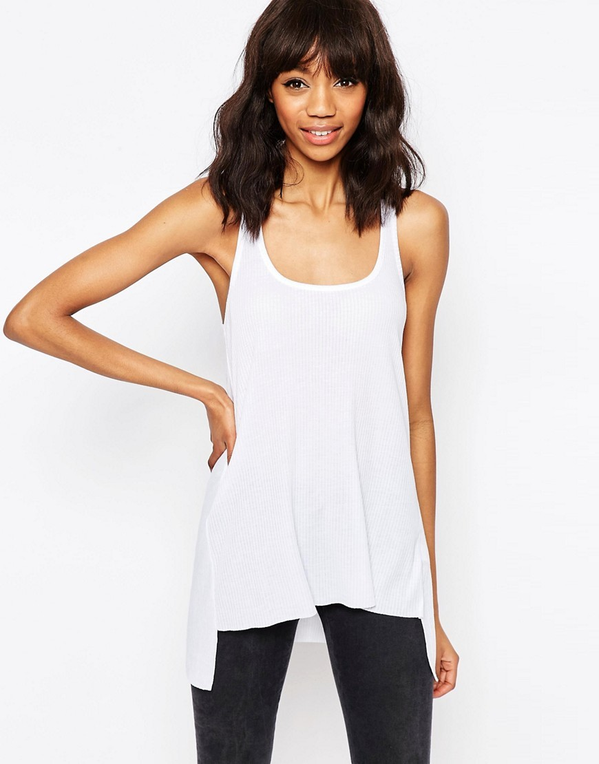 Vest With Step Back Hem In Rib White - pattern: plain; sleeve style: sleeveless; length: below the bottom; style: vest top; predominant colour: white; occasions: casual; neckline: scoop; fibres: polyester/polyamide - mix; fit: body skimming; sleeve length: sleeveless; pattern type: fabric; texture group: jersey - stretchy/drapey; season: s/s 2016; wardrobe: basic