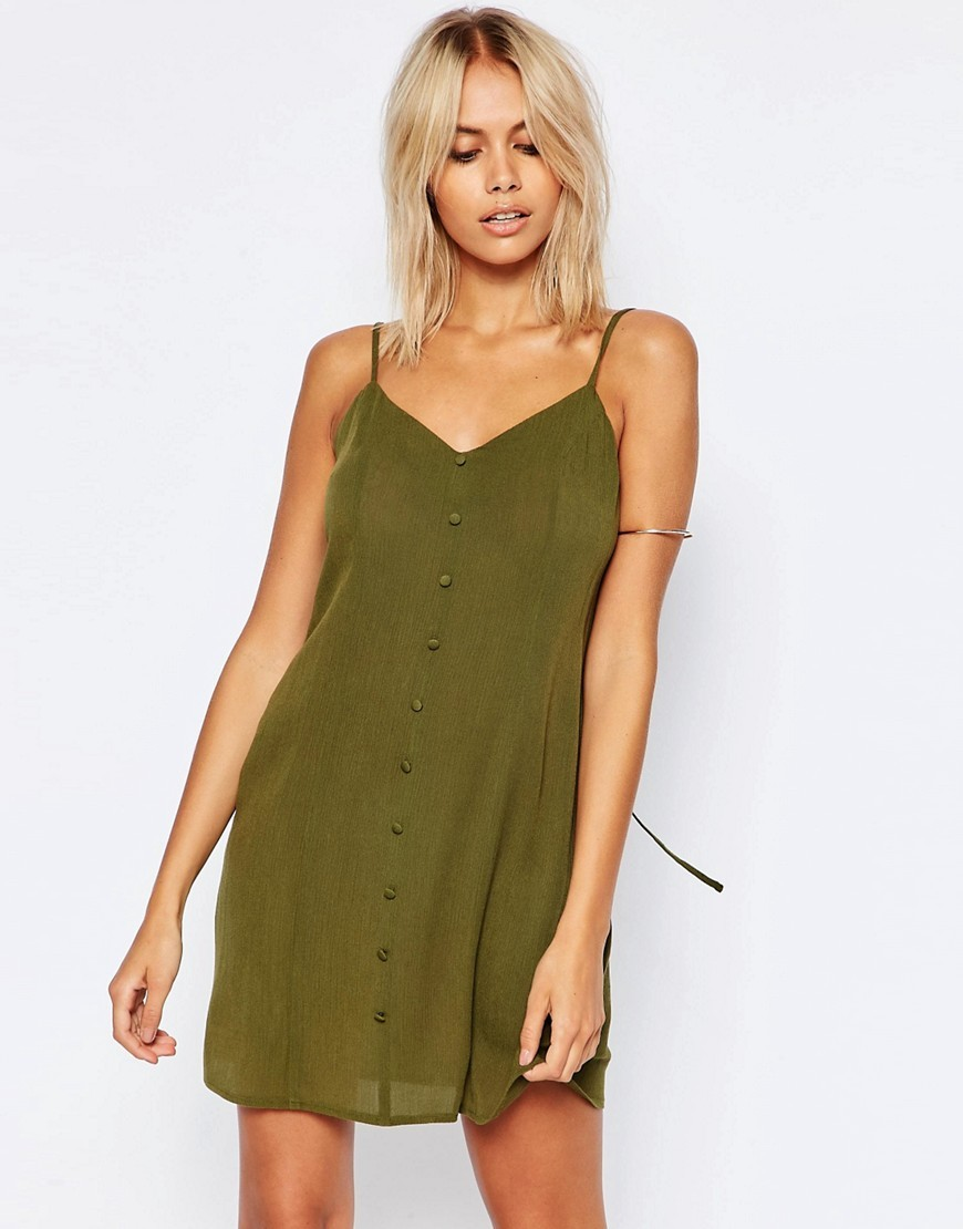 Button Through Sundress Khaki - neckline: v-neck; sleeve style: spaghetti straps; pattern: plain; style: sundress; predominant colour: khaki; occasions: casual; length: just above the knee; fit: body skimming; fibres: viscose/rayon - 100%; sleeve length: sleeveless; pattern type: fabric; texture group: other - light to midweight; season: s/s 2016; wardrobe: basic