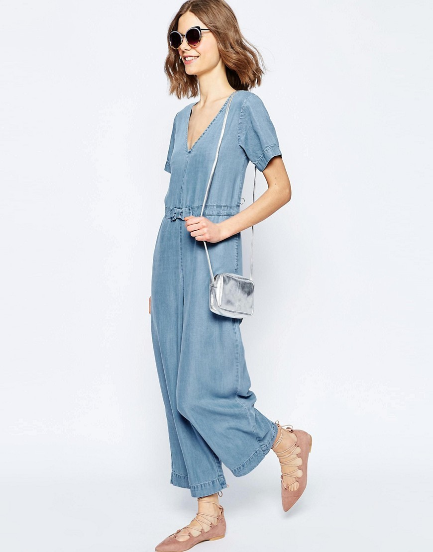 Denim Premium Bow Jumpsuit Midwash Blue - length: standard; neckline: v-neck; fit: loose; pattern: plain; waist detail: belted waist/tie at waist/drawstring; predominant colour: pale blue; occasions: casual; fibres: viscose/rayon - 100%; sleeve length: short sleeve; sleeve style: standard; texture group: denim; style: jumpsuit; pattern type: fabric; season: s/s 2016; wardrobe: highlight