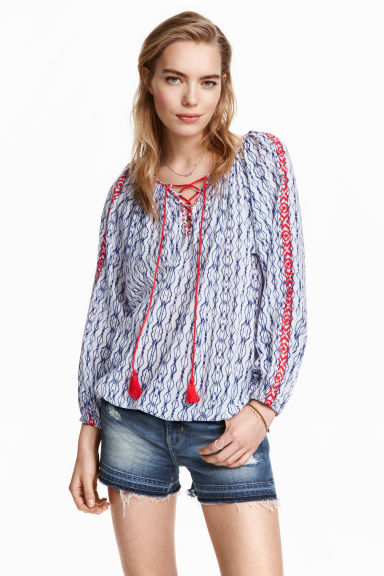 Bohemian Blouse - neckline: v-neck; style: blouse; secondary colour: white; predominant colour: navy; occasions: casual, holiday; length: standard; fibres: cotton - 100%; fit: loose; sleeve length: long sleeve; sleeve style: standard; texture group: cotton feel fabrics; pattern type: fabric; pattern size: standard; pattern: patterned/print; embellishment: embroidered; season: s/s 2016; wardrobe: highlight; embellishment location: bust