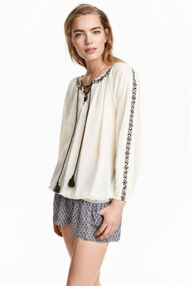 Bohemian Blouse - neckline: round neck; length: below the bottom; style: blouse; predominant colour: ivory/cream; secondary colour: black; occasions: casual; fibres: cotton - 100%; fit: body skimming; sleeve length: long sleeve; sleeve style: standard; pattern type: fabric; pattern size: standard; pattern: patterned/print; texture group: other - light to midweight; embellishment: embroidered; season: s/s 2016; wardrobe: highlight