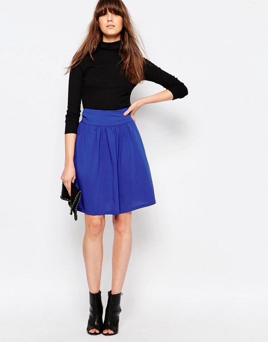 Taimi Drapey Midi Skirt 2146826246 - pattern: plain; fit: loose/voluminous; waist: high rise; predominant colour: royal blue; occasions: casual, creative work; length: just above the knee; style: a-line; fibres: viscose/rayon - stretch; hip detail: soft pleats at hip/draping at hip/flared at hip; waist detail: narrow waistband; pattern type: fabric; texture group: jersey - stretchy/drapey; season: s/s 2016; wardrobe: highlight