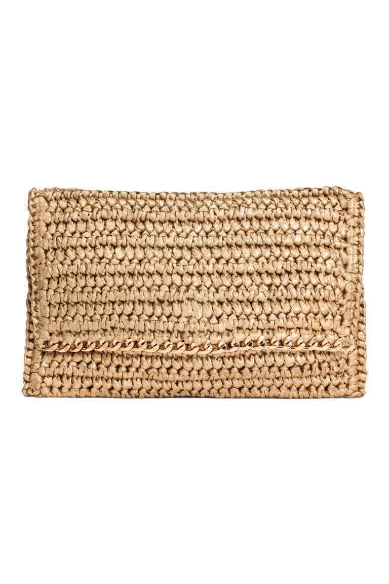 Straw Clutch - predominant colour: gold; occasions: casual, creative work; type of pattern: standard; style: clutch; length: hand carry; size: small; material: macrame/raffia/straw; pattern: plain; finish: plain; season: s/s 2016; wardrobe: highlight