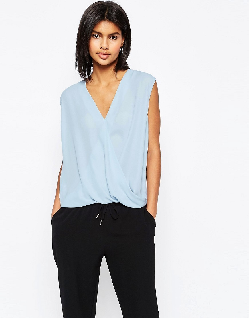 Sleeveless Drape Wrap Blouse Blue - neckline: v-neck; sleeve style: capped; pattern: plain; style: blouse; predominant colour: pale blue; occasions: casual; length: standard; fibres: polyester/polyamide - 100%; fit: body skimming; sleeve length: sleeveless; pattern type: fabric; texture group: other - light to midweight; season: s/s 2016; wardrobe: highlight