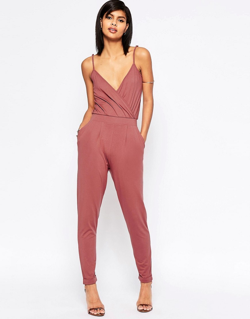 Cami Wrap Front Jersey Jumpsuit With Peg Leg Rosewood - length: standard; neckline: low v-neck; sleeve style: spaghetti straps; pattern: plain; predominant colour: pink; occasions: casual; fit: body skimming; fibres: viscose/rayon - stretch; sleeve length: sleeveless; style: jumpsuit; pattern type: fabric; texture group: jersey - stretchy/drapey; season: s/s 2016; wardrobe: highlight