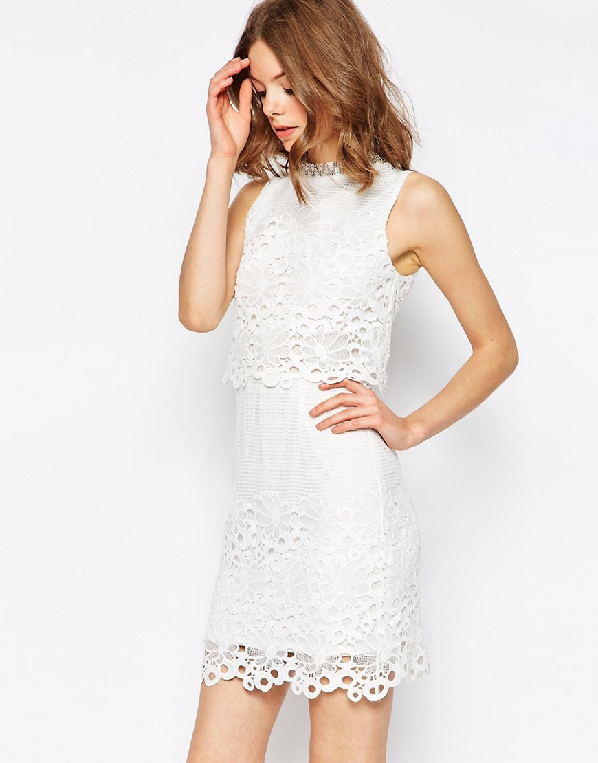 Lace Cut Work High Neck Embellished Mini Dress White - style: shift; length: mini; fit: tailored/fitted; sleeve style: sleeveless; neckline: high neck; predominant colour: white; occasions: evening; fibres: polyester/polyamide - 100%; sleeve length: sleeveless; texture group: lace; pattern type: fabric; pattern: patterned/print; season: s/s 2016; wardrobe: event