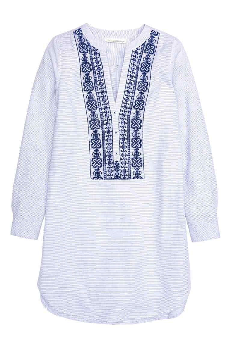 Cotton Tunic - neckline: v-neck; length: below the bottom; style: tunic; predominant colour: white; secondary colour: navy; occasions: casual; fibres: cotton - 100%; fit: loose; sleeve length: long sleeve; sleeve style: standard; texture group: cotton feel fabrics; pattern type: fabric; pattern: patterned/print; embellishment: embroidered; multicoloured: multicoloured; season: s/s 2016; wardrobe: highlight; embellishment location: bust