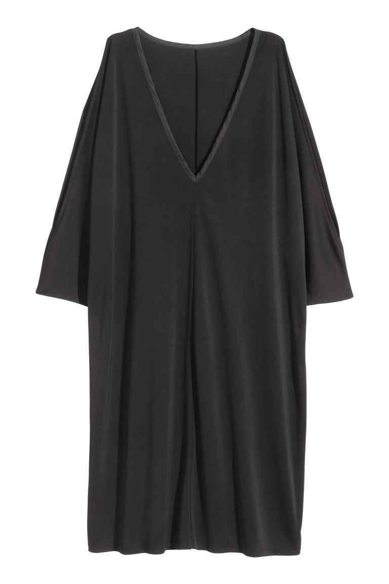 + Cold Shoulder Tunic - style: tunic; neckline: v-neck; pattern: plain; predominant colour: black; occasions: evening; length: just above the knee; fit: body skimming; fibres: polyester/polyamide - 100%; shoulder detail: cut out shoulder; sleeve length: 3/4 length; sleeve style: standard; pattern type: fabric; texture group: jersey - stretchy/drapey; season: s/s 2016