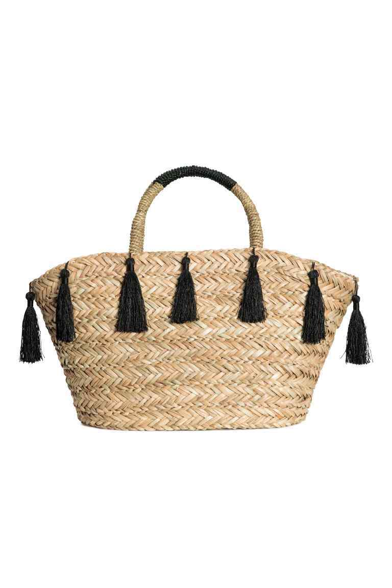 Straw Shopper - predominant colour: camel; secondary colour: black; occasions: casual, holiday; type of pattern: standard; style: tote; length: handle; size: standard; material: macrame/raffia/straw; embellishment: tassels; pattern: plain; finish: plain; multicoloured: multicoloured; season: s/s 2016; wardrobe: highlight