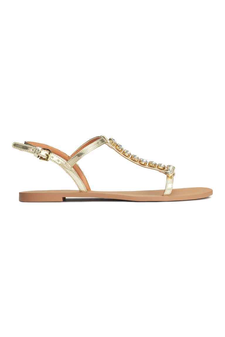 Sparkly Sandals - predominant colour: gold; material: faux leather; heel height: flat; embellishment: crystals/glass; ankle detail: ankle strap; heel: standard; toe: toe thongs; style: standard; occasions: holiday; finish: metallic; pattern: plain; season: s/s 2016; wardrobe: highlight