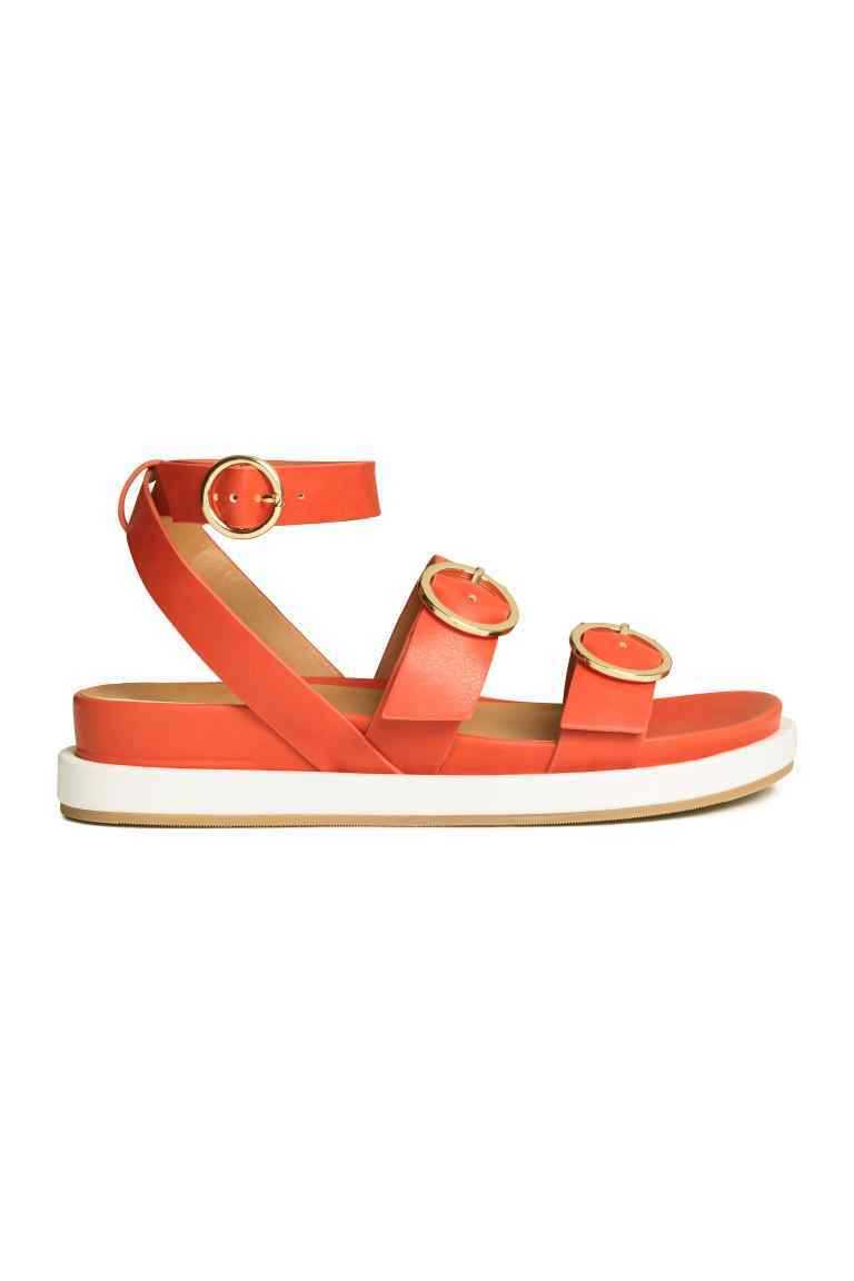 Sandals - predominant colour: bright orange; occasions: casual, holiday; material: faux leather; heel height: flat; embellishment: buckles; ankle detail: ankle strap; heel: standard; toe: open toe/peeptoe; style: strappy; finish: plain; pattern: plain; season: s/s 2016; wardrobe: highlight