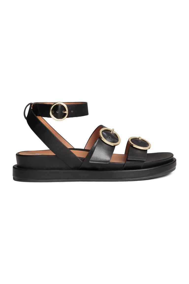 Sandals - predominant colour: black; occasions: casual; material: faux leather; heel height: flat; embellishment: buckles; ankle detail: ankle strap; heel: standard; toe: open toe/peeptoe; style: strappy; finish: plain; pattern: plain; shoe detail: platform; season: s/s 2016; wardrobe: highlight