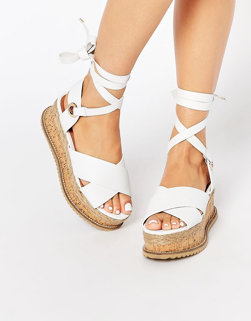 Kg Kurt Geiger Noah White Leather Tie Up Flatform Sandals White - predominant colour: white; occasions: casual, holiday; material: leather; heel height: flat; ankle detail: ankle tie; heel: wedge; toe: open toe/peeptoe; style: standard; finish: plain; pattern: plain; shoe detail: platform; season: s/s 2016; wardrobe: basic