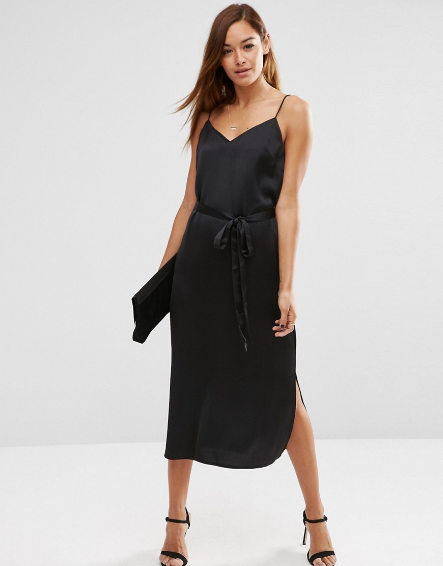 Midi Slip Dress In Satin With Tie Waist Black - neckline: low v-neck; sleeve style: spaghetti straps; pattern: plain; style: maxi dress; length: ankle length; waist detail: belted waist/tie at waist/drawstring; predominant colour: black; occasions: evening; fit: body skimming; fibres: polyester/polyamide - 100%; sleeve length: sleeveless; texture group: structured shiny - satin/tafetta/silk etc.; pattern type: fabric; season: s/s 2016; wardrobe: event