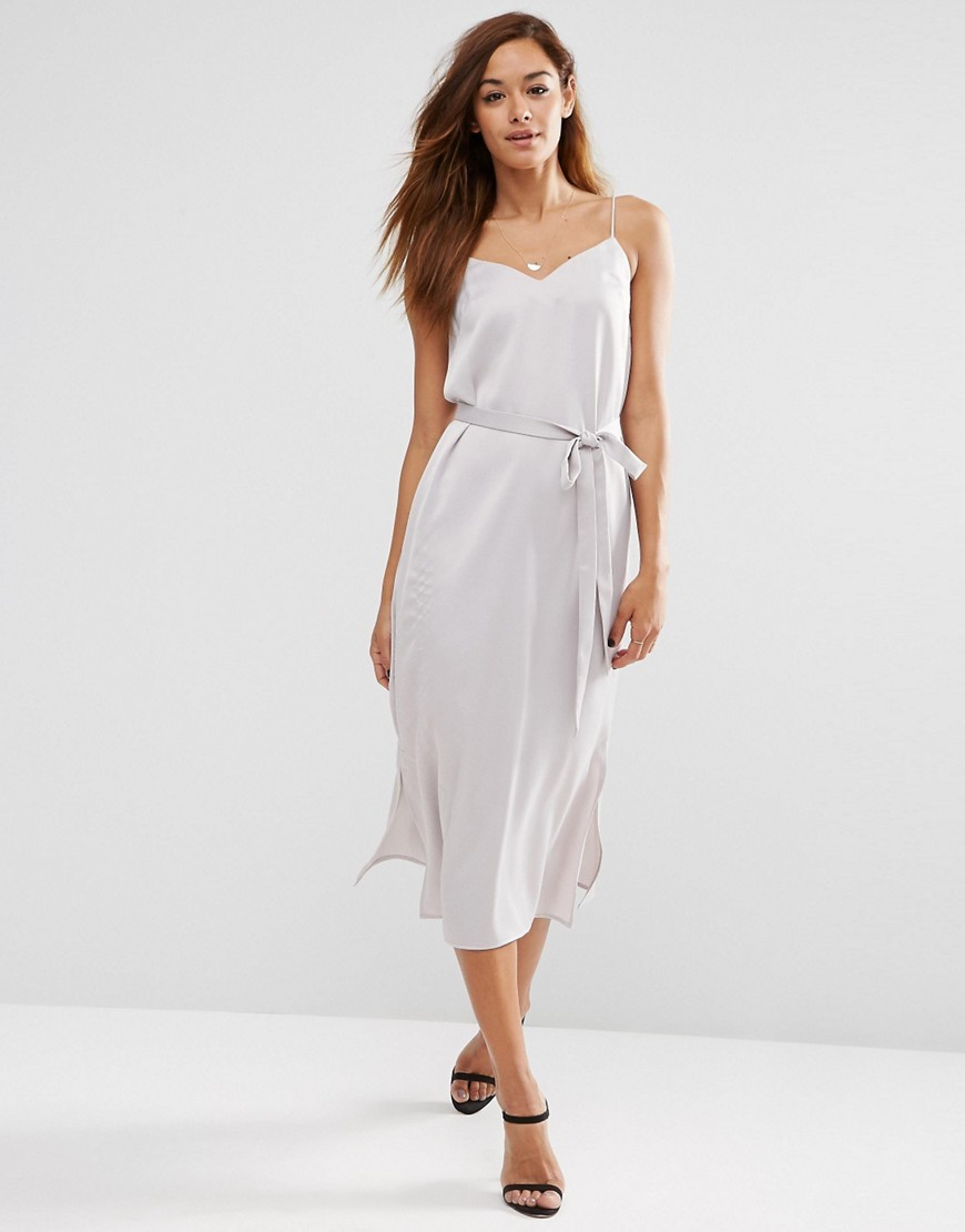 Midi Slip Dress In Satin With Tie Waist Grey - length: calf length; neckline: low v-neck; sleeve style: spaghetti straps; pattern: plain; waist detail: belted waist/tie at waist/drawstring; predominant colour: light grey; occasions: evening; fit: body skimming; style: slip dress; fibres: polyester/polyamide - 100%; sleeve length: sleeveless; texture group: structured shiny - satin/tafetta/silk etc.; pattern type: fabric; season: s/s 2016; wardrobe: event