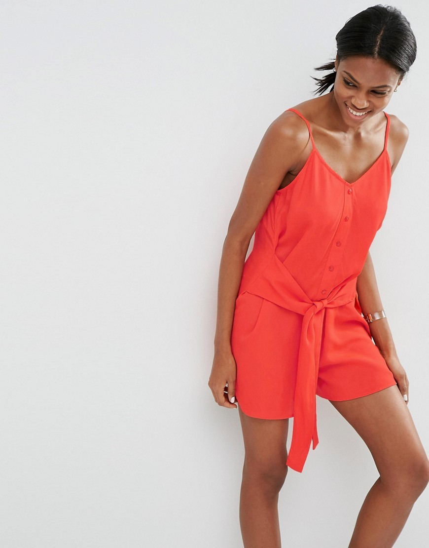 Tie Front Button Up Playsuit Red - neckline: low v-neck; sleeve style: spaghetti straps; fit: fitted at waist; pattern: plain; waist detail: belted waist/tie at waist/drawstring; length: short shorts; predominant colour: true red; occasions: casual, holiday; fibres: viscose/rayon - 100%; sleeve length: sleeveless; style: playsuit; pattern type: fabric; texture group: jersey - stretchy/drapey; season: s/s 2016; wardrobe: holiday