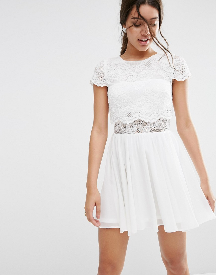 Crop Top Lace Mini Dress White - length: mid thigh; sleeve style: capped; pattern: plain; predominant colour: white; occasions: evening; fit: fitted at waist & bust; style: fit & flare; fibres: nylon - mix; neckline: crew; waist detail: cut out detail; sleeve length: short sleeve; texture group: cotton feel fabrics; pattern type: fabric; embellishment: lace; season: s/s 2016; wardrobe: event