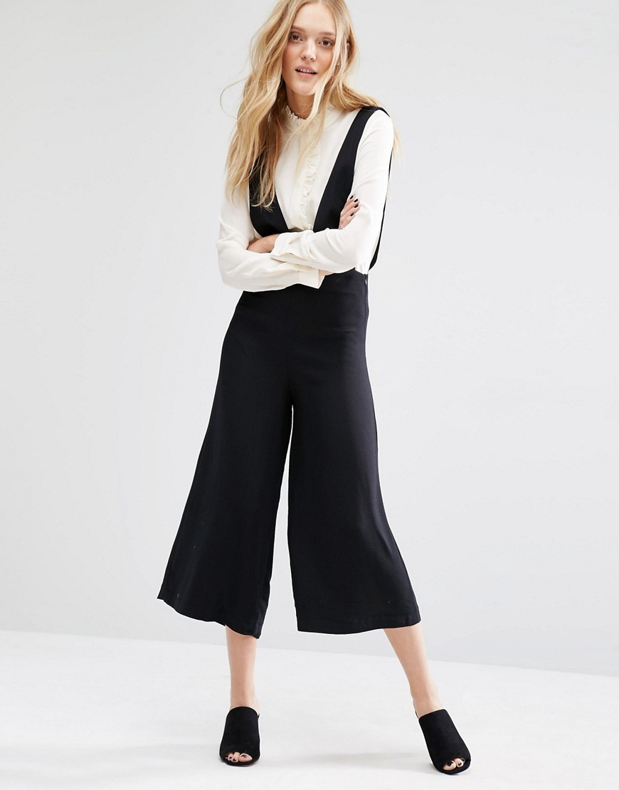 Culotte Jumpsuit Black - neckline: plunge; fit: fitted at waist; pattern: plain; sleeve style: sleeveless; length: below the knee; predominant colour: black; fibres: viscose/rayon - 100%; sleeve length: sleeveless; style: jumpsuit; pattern type: fabric; texture group: other - light to midweight; occasions: creative work; season: s/s 2016; wardrobe: highlight