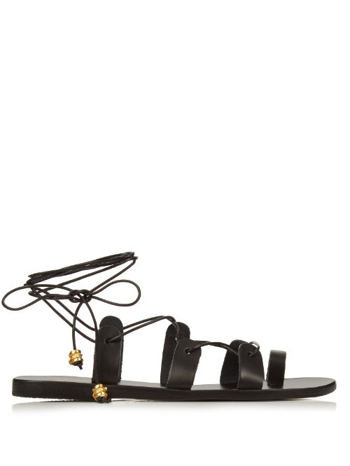 X Ilias Lalaounis Alcyone Leather Sandals - predominant colour: black; occasions: casual, holiday; material: leather; heel height: flat; ankle detail: ankle tie; heel: block; toe: open toe/peeptoe; style: gladiators; finish: plain; pattern: plain; season: s/s 2016; wardrobe: basic