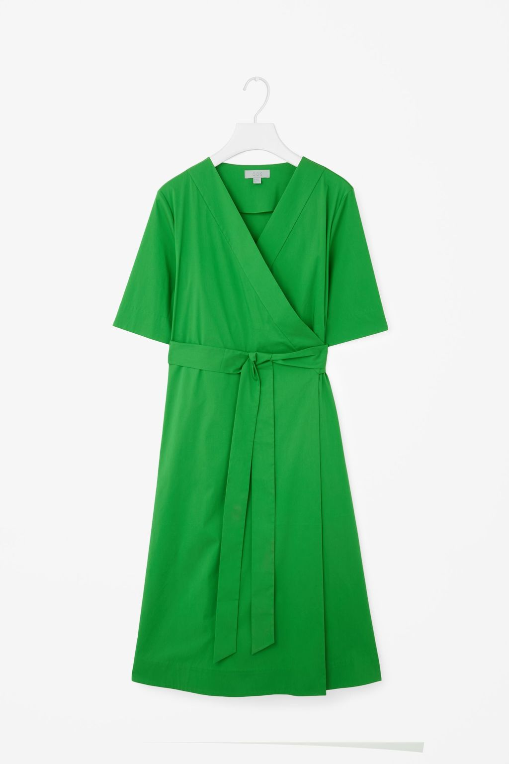 Wrap Over Dress - style: faux wrap/wrap; neckline: v-neck; pattern: plain; predominant colour: emerald green; occasions: evening; length: on the knee; fit: body skimming; fibres: cotton - stretch; sleeve length: short sleeve; sleeve style: standard; pattern type: fabric; texture group: other - light to midweight; season: s/s 2016