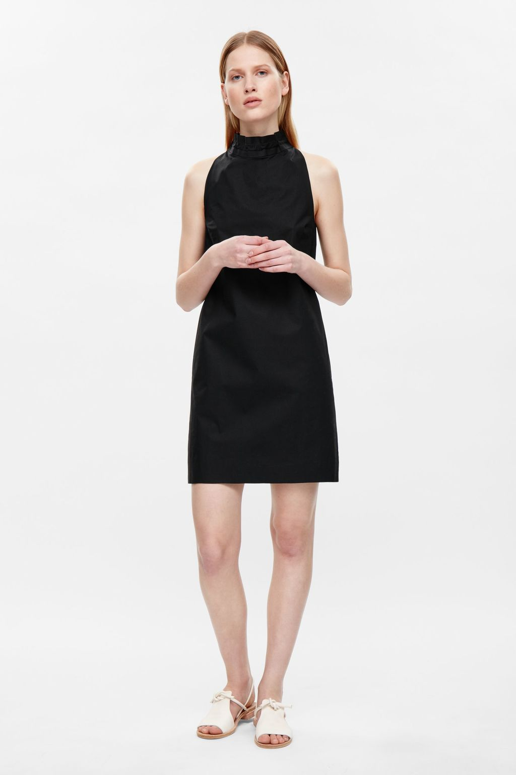 Dress With Tie Collar - style: shift; length: mid thigh; pattern: plain; sleeve style: sleeveless; neckline: high neck; predominant colour: black; occasions: casual; fit: body skimming; fibres: cotton - stretch; sleeve length: sleeveless; pattern type: fabric; texture group: other - light to midweight; season: s/s 2016; wardrobe: basic