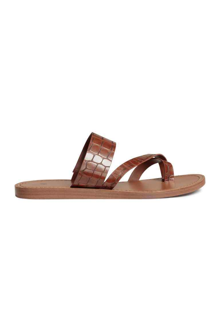 Sandals - predominant colour: tan; occasions: casual; material: faux leather; heel height: flat; heel: standard; toe: toe thongs; style: standard; finish: plain; pattern: plain; season: s/s 2016; wardrobe: highlight