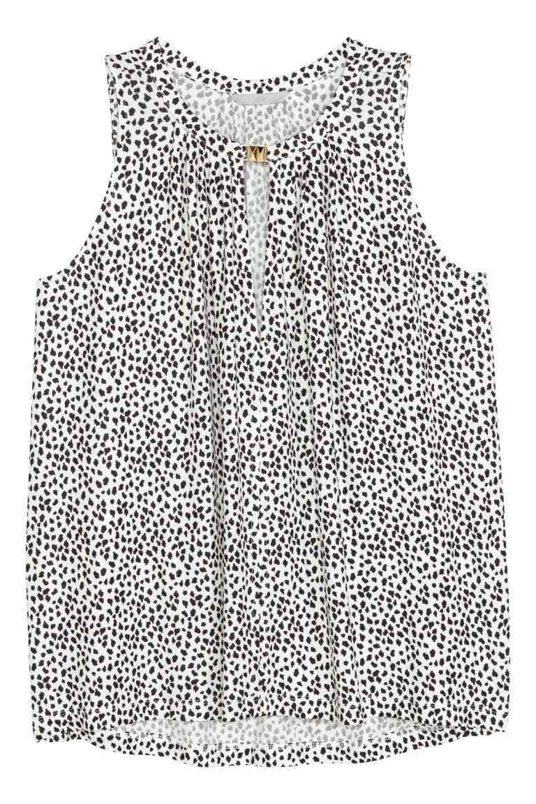 Sleeveless Jersey Top - sleeve style: sleeveless; secondary colour: white; predominant colour: black; occasions: casual; length: standard; style: top; neckline: peep hole neckline; fibres: viscose/rayon - 100%; fit: body skimming; sleeve length: sleeveless; pattern type: fabric; pattern: patterned/print; texture group: jersey - stretchy/drapey; multicoloured: multicoloured; season: s/s 2016; wardrobe: highlight