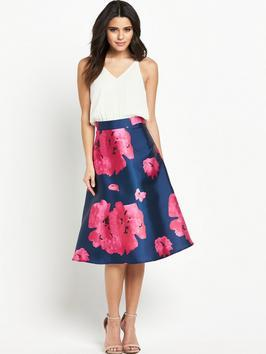 Strappy Dress With Plain Top And Printed Skirt - length: below the knee; neckline: v-neck; sleeve style: spaghetti straps; fit: fitted at waist; style: prom dress; secondary colour: hot pink; predominant colour: navy; fibres: polyester/polyamide - 100%; occasions: occasion; waist detail: narrow waistband; sleeve length: sleeveless; texture group: structured shiny - satin/tafetta/silk etc.; pattern type: fabric; pattern size: big & busy; pattern: florals; season: s/s 2016