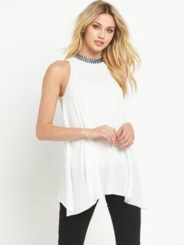 High Neck Embellished Blouse - pattern: plain; sleeve style: sleeveless; length: below the bottom; predominant colour: white; occasions: casual, evening; style: top; fibres: polyester/polyamide - 100%; fit: loose; neckline: crew; sleeve length: sleeveless; pattern type: fabric; texture group: jersey - stretchy/drapey; embellishment: crystals/glass; season: s/s 2016; wardrobe: highlight