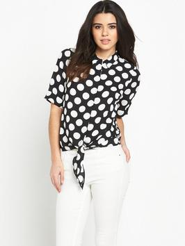 Knot Front Spot Print Blouse - neckline: shirt collar/peter pan/zip with opening; style: blouse; pattern: polka dot; secondary colour: white; predominant colour: black; occasions: casual, work, creative work; length: standard; fibres: polyester/polyamide - 100%; fit: body skimming; sleeve length: short sleeve; sleeve style: standard; pattern type: fabric; pattern size: standard; texture group: other - light to midweight; season: s/s 2016; wardrobe: highlight