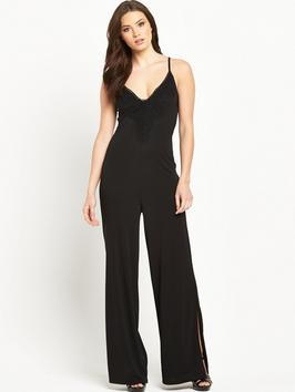 Petite Split Leg Lace Trim Jersey Jumpsuit - length: standard; neckline: v-neck; sleeve style: spaghetti straps; pattern: plain; predominant colour: black; occasions: evening; fit: body skimming; fibres: cotton - stretch; sleeve length: sleeveless; style: jumpsuit; pattern type: fabric; texture group: jersey - stretchy/drapey; season: s/s 2016; wardrobe: event