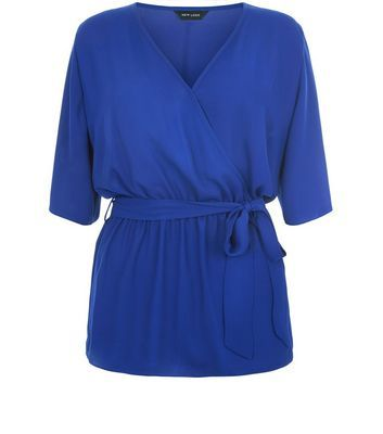 Blue Belted Wrap 1/2 Sleeve Top - neckline: low v-neck; pattern: plain; style: wrap/faux wrap; waist detail: belted waist/tie at waist/drawstring; predominant colour: royal blue; occasions: casual, creative work; length: standard; fibres: polyester/polyamide - 100%; fit: body skimming; sleeve length: half sleeve; sleeve style: standard; pattern type: fabric; texture group: jersey - stretchy/drapey; season: s/s 2016; wardrobe: highlight
