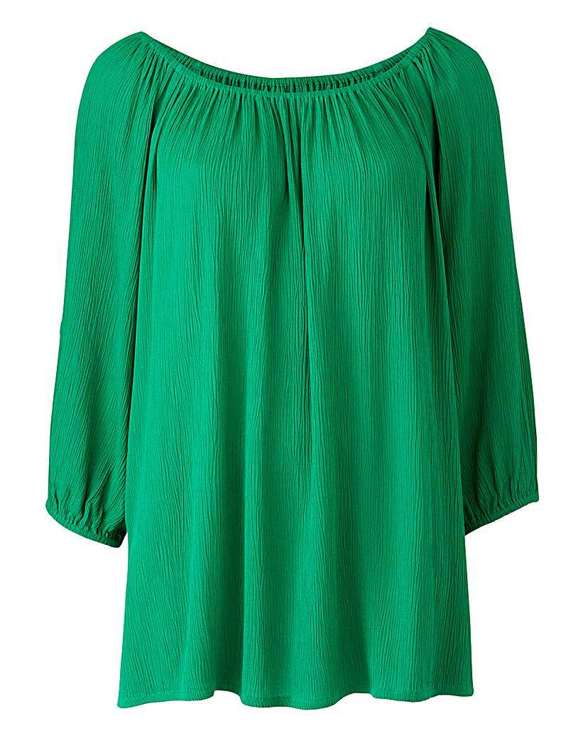 Green Cold Shoulder Gypsy Top - neckline: round neck; pattern: plain; predominant colour: emerald green; occasions: casual; length: standard; style: top; fibres: viscose/rayon - 100%; fit: loose; sleeve length: long sleeve; sleeve style: standard; texture group: cotton feel fabrics; pattern type: fabric; season: s/s 2016; wardrobe: highlight